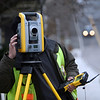 ALLEGRA BOVERMAN/Staff photo. Gloucester Daily Times. Gloucester: Paul Arruda, a survey technician of SMC of Brookline, does surveying work along Centennial Avenue near the Gloucester High School track and field as part of the improvement to that area.