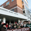 ALLEGRA BOVERMAN/Staff photo. Gloucester Daily Times. Gloucester: Concerned citizens, including several nurses, gathered at Addison Gilbert Hospital on Tuesday afternoon. They will attend the hearing on Thursday evening to be held by the state department of public health.