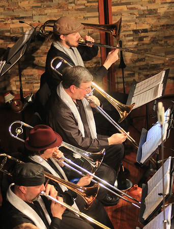 JIm Vaiknoras/Gloucester Times: The trombome section of the Cape Ann Big Band perform  in hats and scarfs at the Shalin Liu Performance Center during New Years Rockport Eve.