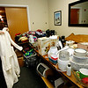 Allegra Boverman/Gloucester Daily Times. City Council member Melissa Cox organizes donations such as the bathrobe she's folding, at the Cruiseport room set aside for a clothing and household necessities drive being held to aid victims of the recent fires in the city.