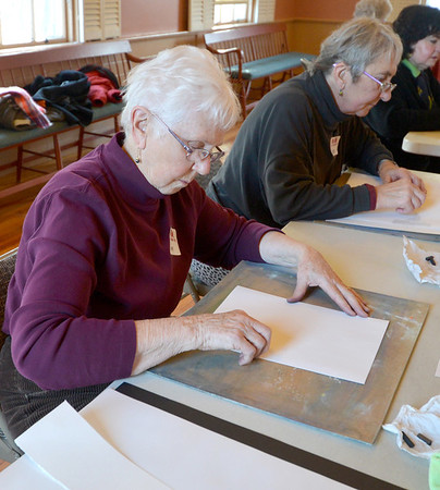 """Jim Vaiknoras/Gloucester Daily Time: Gerre Wescott and Babette Brackett begin their sketches in Carla Mattioli's class """"Light, Shadow & Color Prismatics"""" at the Rockport Senior Center Tuesday. About a dozen artists attended the class , which runs weekly till Feb. 19th."""