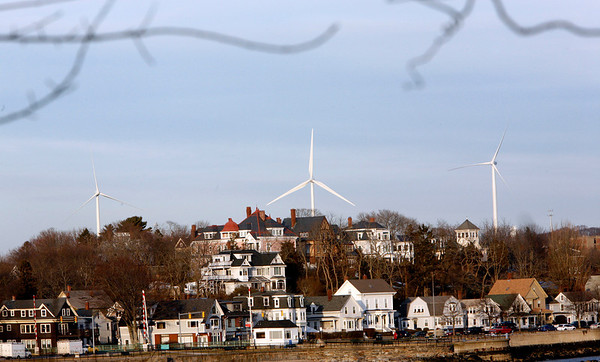 Allegra Boverman/Gloucester Daily Times. The three turbines in Gloucester as seen from Stage Fort Park.