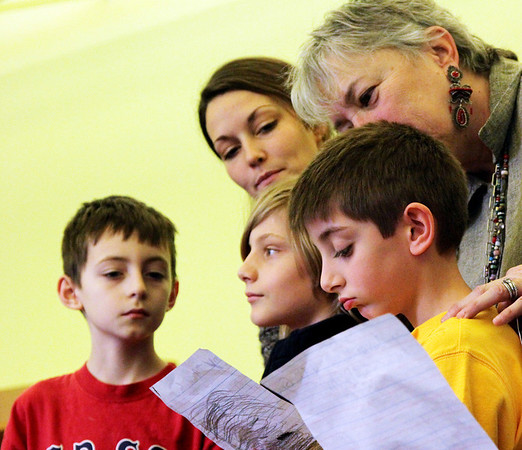 Allegra Boverman/Gloucester Daily Times. During the final assembly at the Gloucester Community Arts Charter School on Wednesday morning. In front, from left are: third graders Mikey Robinson, Chase Ahearn, Joshua Amaral,  and behind them from left are their teacher Brittany Rose and principal Beth Delforge.