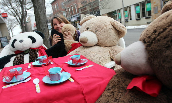 Allegra Boverman/Gloucester Daily Times. Susan Parent, owner of Toodeloos!, is relieved that her trio of tea-drinking bears that daily sit in front of her Main Street store is complete again. The panda, Kevin, left, the baby bear of the group, is back safe and sound after being stolen on Saturday. At center and right are Lulu and Michelle, the mama and papa bears.