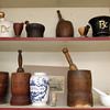 Allegra Boverman/Gloucester Daily Times. Conley's Drug Store has collections of old medicine bottles and other antique pharmaceutical industry items such as these mortars and pestles on display in both their pharmacies. These are at the Gloucester store.