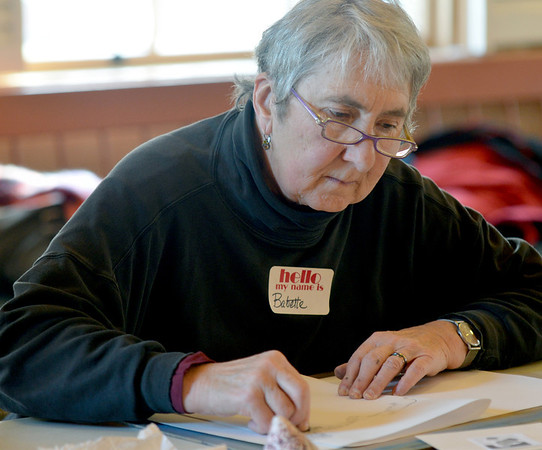 """Jim Vaiknoras/Gloucester Daily Time: Babette Brackett begins sketching in Carla Mattioli's class """"Light, Shadow & Color Prismatics"""" at the Rockport Senior Center Tuesday. About a dozen artists attended the class , which runs weekly till Feb. 19th."""