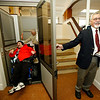 Allegra Boverman/Gloucester Daily Times. During the unveiling of various Americans with Disabilities Act improvements at the Unitarian Universalist Church in Gloucester on Wednesday, Joe Randazza, left, tries out one of the new lifts accompanied by Newt Fink, behind him, grounds manager, and at right, Charles Nazarian, chair of the church's restoration committee.