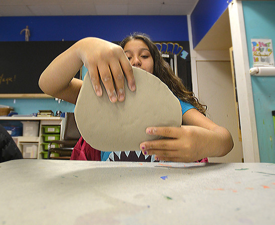 JIm Vaiknoras/Gloucester Daily Times : Pharah Donlan works a piece of clay at a Clay Beginners class at Art Haven in Gloucester.The bi-weekly class is held Monday and Wednesday from 3:30-5.