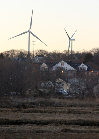 Allegra Boverman/Gloucester Daily Times. The turbines as seen from the Shop & Stop Supermarket entrance off Bass Avenue in Gloucester.