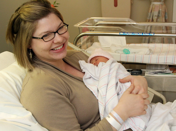 Allegra Boverman/Gloucester Daily Times. Emily DeCastro of Gloucester and her newborn baby Kaia Camilla, who was the first baby of the new year born at the North Shore Birth Center at Beverly Hospital.