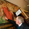 "Allegra Boverman/Gloucester Daily Times. Peter Williams of Peter Williams Museum Services of Boston, talks about the various kinds of damage that has taken place on this mural that is next to the City Hall clerk's office, some also from the radiator below. This mural, titled ""Poetry,"" is by Charles Allen Winter, who did many of the murals on the first floor. This work will be restored by him and his team."