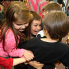 Allegra Boverman/Gloucester Daily Times. During the final assembly at the Gloucester Community Arts Charter School on Wednesday morning.  Hugging are, from left:  Alanna and Vanessa Korthas, Ian and Elliott Markowitz, and Drew Chouinard.