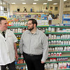 Allegra Boverman/Gloucester Daily Times. From left: Bill Caperci and Alex Doyle are pharmacists who are co-owners of Conley's Drug Store in Gloucester, along with Doyle's parents, Richard and Marlene Doyle. The store is currently doubling in size.