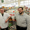 Allegra Boverman/Gloucester Daily Times. Left: Bill Caperci and Alex Doyle, both pharmacists, are co-owners, along with Doyle's parents Richard and Marlene Doyle, of Conley's Drug Store in Gloucester. The store is currently doubling in size.