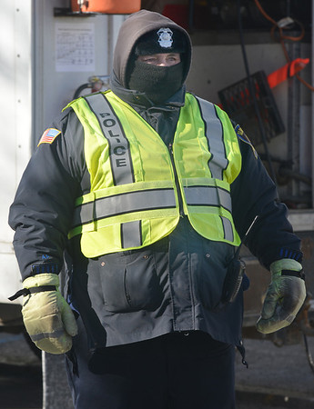 Jim Vaiknoras/Gloucester Daily Times:With tempuratures not expected to leave the teens,  Officer Mark Foote bundled up to work a road detail on Prospect Street in Gloucester.