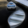 Jim Vaiknoras/ Gloucester Times: A trio of boats sit covered in snow at the dock at Masconomo Park in Manchester.