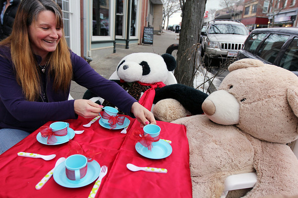 Allegra Boverman/Gloucester Daily Times. Susan Parent, owner of Toodeloos! in downtown Gloucester, is relieved that her trio of tea-drinking bears that daily sit in front of her Main Street store is complete again. The panda, Kevin, the baby bear of the group, is back after being stolen on Saturday. At right is Lulu, the mama bear, and not shown, Michelle, the papa bear.