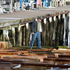 Allegra Boverman/Gloucester Daily Times. Ed Wayman, foreman of Gloucester Marine Railways, at work in the Rocky Neck location on Tuesday afternoon.