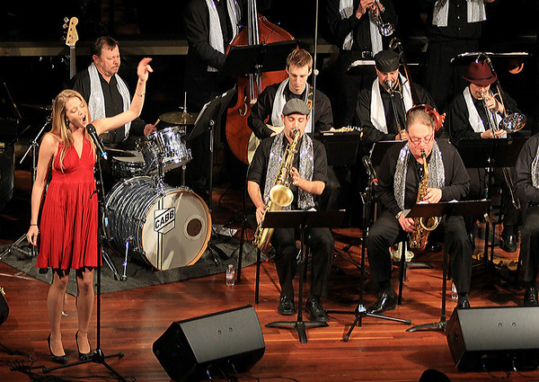 JIm Vaiknoras/Gloucester Times: Marina Evans sings with the Cape Ann Big Band to a full house at the Shalin Liu Performance Center during New Years Rockport Eve.