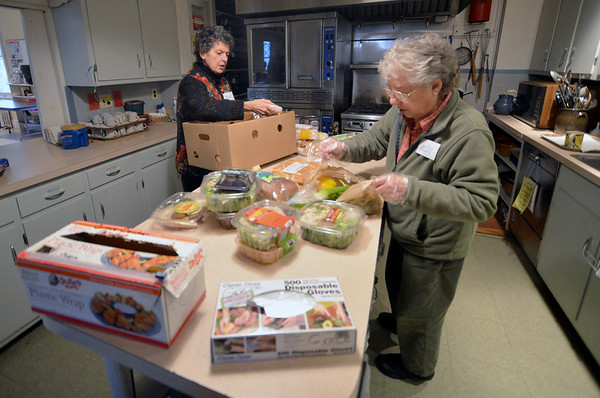 Jim Vaiknoras/Gloucester Daily Times:Volunteers Peggy Wakeman and Cecily Merrell begin to prepare lunch at St John's Church in Gloucester.
