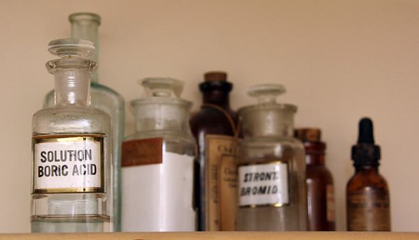 Allegra Boverman/Gloucester Daily Times. Conley's Drug Store has collections of old medicine bottles and other antique pharmaceutical industry items on display in both their pharmacies. These are at the Gloucester store.