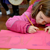 Jim Vaiknoras/Gloucester Daily Times: Grace Englis, 6, make a sign reading peace that she carried in the 25th annual Martin Luther King jr march at the Unitarian Universalist Church in Rockport Monday morning.