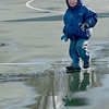 Jim Vaiknoras/Gloucester Daily Time: Jack Fonti, 2, slashes in a puddle on the basketball court at Fort Point Park in Gloucester. Jack braved the cold weather to head out and play with his mom Hannah.