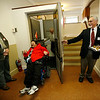 Allegra Boverman/Gloucester Daily Times. During the unveiling of various Americans with Disabilities Act improvements at the Unitarian Universalist Church in Gloucester on Wednesday, joe Randazza, center, emerges from one of the new lifts. From left around him are Dick Prouty, chair of the church's board, Newt Fink, grounds manager, and at right, Charles Nazarian, chair of the church's restoration committee.