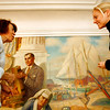 "Allegra Boverman/Gloucester Daily Times. Painting conservators Jackie Trombley, left, and Stephanie Angelo are restoring the ""City Government"" mural in Gloucester's City Hall. They work with Peter Williams Museum Services and will be working on several murals in the first floor of the building for the next few weeks."