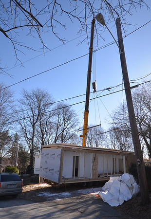 Jim Vaiknoras/Gloucester Daily Times: A crane moves a piece of modular home on Ashland Place in Gloucester THursday.