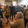 Desi Smith/Gloucester Daily Times<br /> Rockport artist Betty Lou Schlemm, seated, greets family, friends and former students at a surprise party celebrating her 80th birthday at the Rockport Community House on Jan. 12, 2014.