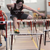 PAUL BILODEAU/Staff photo<br /> <br /> Gloucester's Jared Marshall has trouble clearing the final hurdle during the 55 Meter hurdles at the NEC track meet at Marblehead High School.