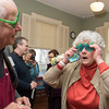 Desi Smith/Gloucester Daily Times<br /> Desi Smith/Gloucester Daily Times<br /> Rockport artist Betty Lou Schlemm tries on a pair of birthday shades at a surprise party celebrating her 80th birthday Event at the Rockport Community House on Jan. 12, 2014.