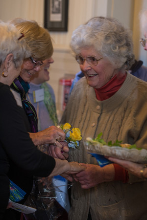 Desi Smith/Gloucester Daily Times<br /> Rockport artist  Betty Lou Schlemm gets a wrist corsage as she walks into her surprise party celebrating her 80th birthday Event at the Rockport Community House on Jan. 12, 2014.