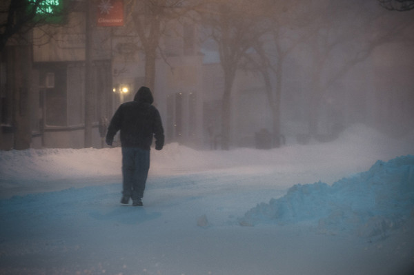 Desi Smith Staff photo/Gloucester Daily Times.   A man makes his way down Main St as the winds and snow fall in the early morning during Friday's storm.        <br /> January 3,2013.