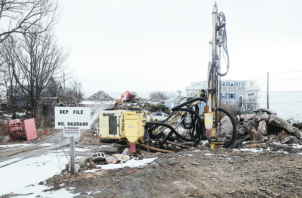 PAUL BILODEAU/Gloucester Daily Times<br /> Equipment is already set up at 129R Granite St., where Ron Roma plans to construct a second brick house.