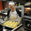 PAUL BILODEAU/Staff photo<br /> <br /> Melissa Hays, owner Sticky Fingers Bakeshop in Gloucester, readies a batch of creme brulee for the refrigerator at her Pleasant Street shop that she runs with her mother Cristina.