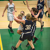 Desi Smith Staff photo/Gloucester Daily Times. Manchester Essex's Eliza Logue is trippled teammed after coming up with a rebound against Hamilton-Wenham Monday night at Manchester High School.  January 27,2013.