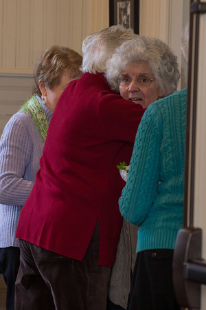 Desi Smith/Gloucester Daily Times<br /> Rockport artist  Betty Lou Schlemm gets a hug as she walks into her surprise party celebrating her 80th birthday Event at the Rockport Community House on Jan. 12, 2014.