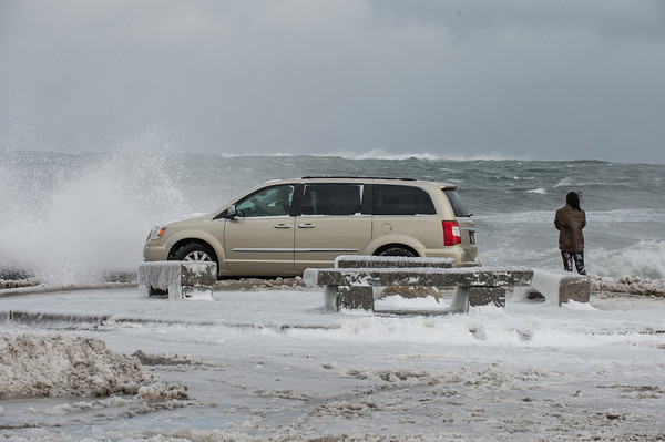 Desi Smith Staff photo/Gloucester Daily Times.  Visitors from Pennsylvania brave the high winds and waves as they stop to take photos at the end of BearSkin Neck in Rockport during Friday's storm.        <br /> January 3,2013.