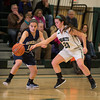 Desi Smith Staff photo/Gloucester Daily Times. Manchester Essex's Sydney Christopher defends against Hamilton-Wenham's Suzanne Rose Monday night at Manchester High School.  January 27,2013.