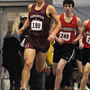 PAUL BILODEAU/Staff photo<br /> <br /> Gloucester's Everest Crawford rounds the corner with Marblehead's Adam Linsky on his heals during the 1-mile run at an NEC track meet at Marblehead High School.