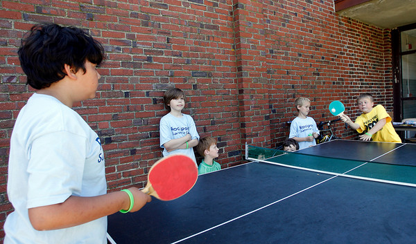 Rockport: Christian Wright, 10, left, and Jason Kluge, 9, right, play ping pong at Rockport Summer Fun Camp on Wednesday afternoon as John Barrington, 10, Matt Daley, 10, Jaden Kamm, 8, and Caleb Hammett, 10, watch. The kids were practicing for a ping pong tournament, which starts Thursday. Photo by Kate Glass/Gloucester Daily Times Wednesday, July 15, 2009