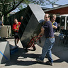Manchester: School custodians, from left Steve Sutherland, Rob Trepanier, front, anf Andy McGilvary, help take a large cabinet out to someone's car during the yard sale at Manchester Essex Hgh School Saturday morning. The school was getting rid of old classroom items to clear out the building before it is torn down. Mary Muckenhoupt/Gloucester Daily Times