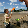 Gloucester: Cameron Marnoto, 2, of Gloucester digs a hole at Niles Beach with his grandmother, Maria Marnoto, Wednesday afternoon. Cameron kept asking Maria to rinse off the shovel because it got dirty as he dug the hole. Photo by Kate Glass/Gloucester Daily Times Wednesday, July 15, 2009