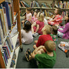 "A group of pajama partiers listen intently to the story of ""One Duck Stuck"" during the pajama party at the TOHP Burnham Essex library last night. Maria Uminski/ Gloucester Daily Times"