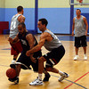 Gloucester: Harbor House's Francis Barani dribbles around Aldos Fitness' Pete Szklarz as they play in the Cape Ann YMCA's 18-plus men's basketball league last night. Photo by Kate Glass/Gloucester Daily Times Monday, July 27, 2009
