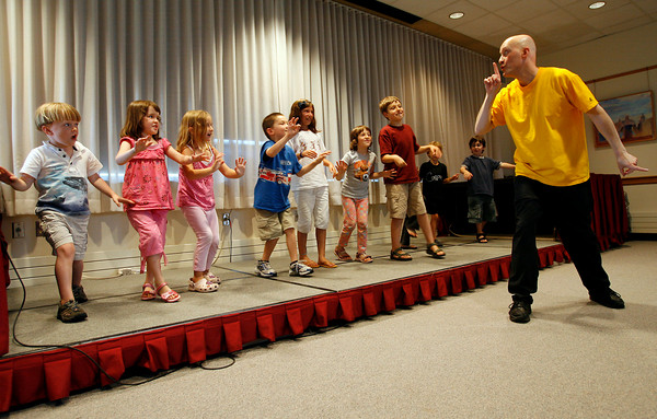 "Rockport: Children at the Rockport Library mimic the motions of comic mime Robert Rivest during a ""Starship Adventure - Science in Motion"" program yesterday afternoon. The children were supposed to mirror Robert's movements. Photo by Kate Glass/Gloucester Daily Times Wednesday, July 22, 2009"