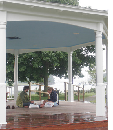 Conrad Luecke of Iowa and Jane McIntyre of New Jersey enjoyed a lunch break yesterday in the gazebo of Masconomo Park after docking with Edgar Crackers' boat. The crew plan to head up north to Maine and Nova Soctia next. Photo by Maria Uminski/ Gloucester Daily Times
