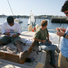 Jake Burchall, a crew trainee, Andrew McKee, 1st mate, and Dan Keenan, 3rd mate, tie whipping knots aboard the Spirit of Bermuda as they dock for a couple days before heading to the Sail Boston on Wednesday. The boat is docked in East Gloucester and the crew says they have only had visitors by boat. Photo by Kate Glass/Gloucester Daily Times Monday, July 6, 2009